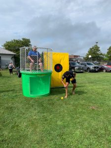 Officer waiting to get dunked in the dunk tank
